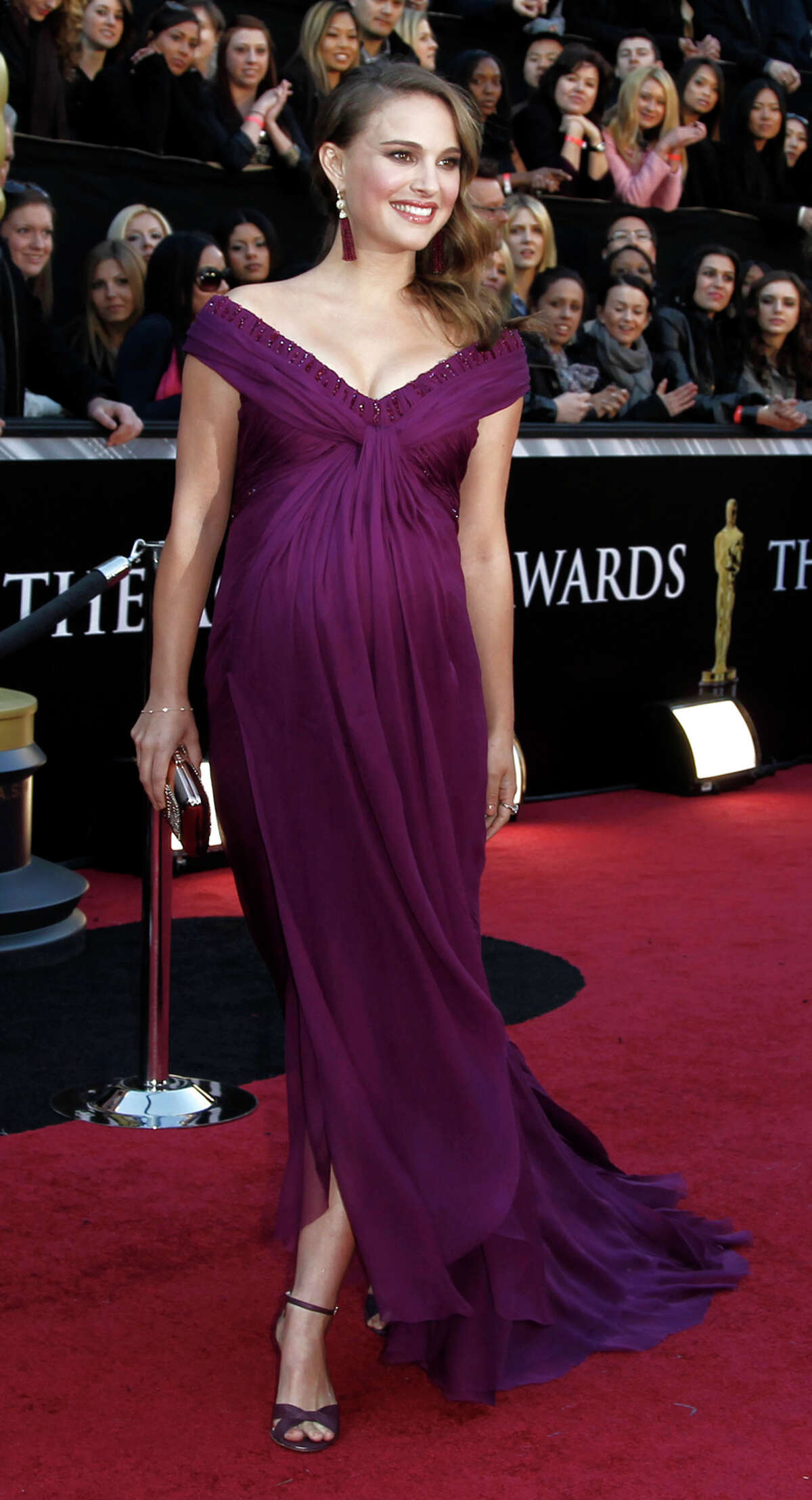 Natalie Portman is rated PG. Perhaps the only pregnant woman in human history who could pull off purple. Commentary by the Houston Chronicle's Kyrie O'Connor of the MeMo blog. Photo by the Associated Press.