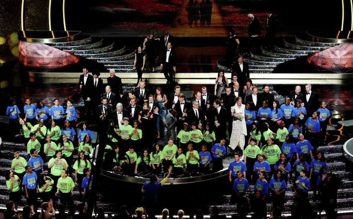 HOLLYWOOD, CA - FEBRUARY 27: The student choir from the New York City/Staten Island School PS 22 performs as the Oscar winners are seen onstage during the 83rd Annual Academy Awards held at the Kodak Theatre on February 27, 2011 in Hollywood, California. (Photo by Kevin Winter/Getty Images)