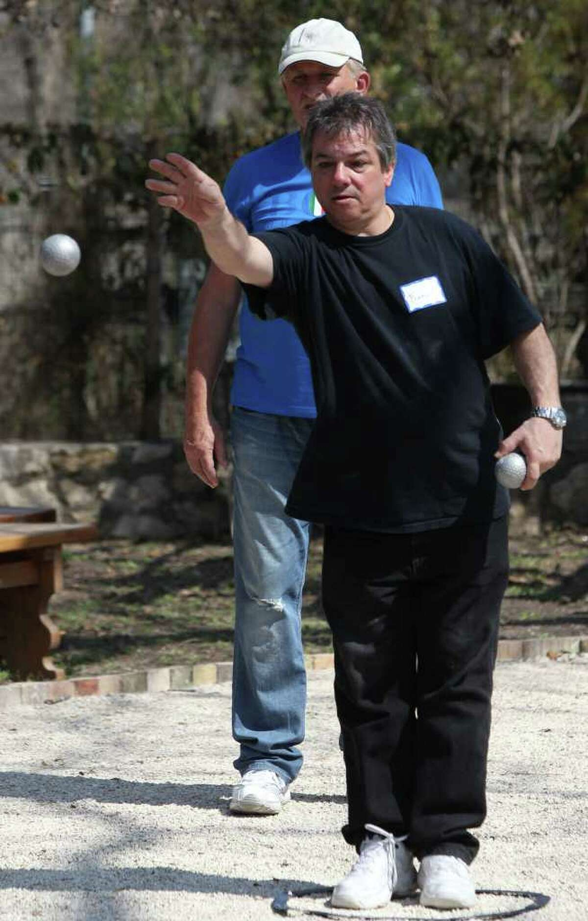 Francis Perrin tosses a ball during a game of petanque on Sunday, Feb. 27, 2011, during the first annual French Cultures Festival. The game is similar to boule and is played chiefly in France.