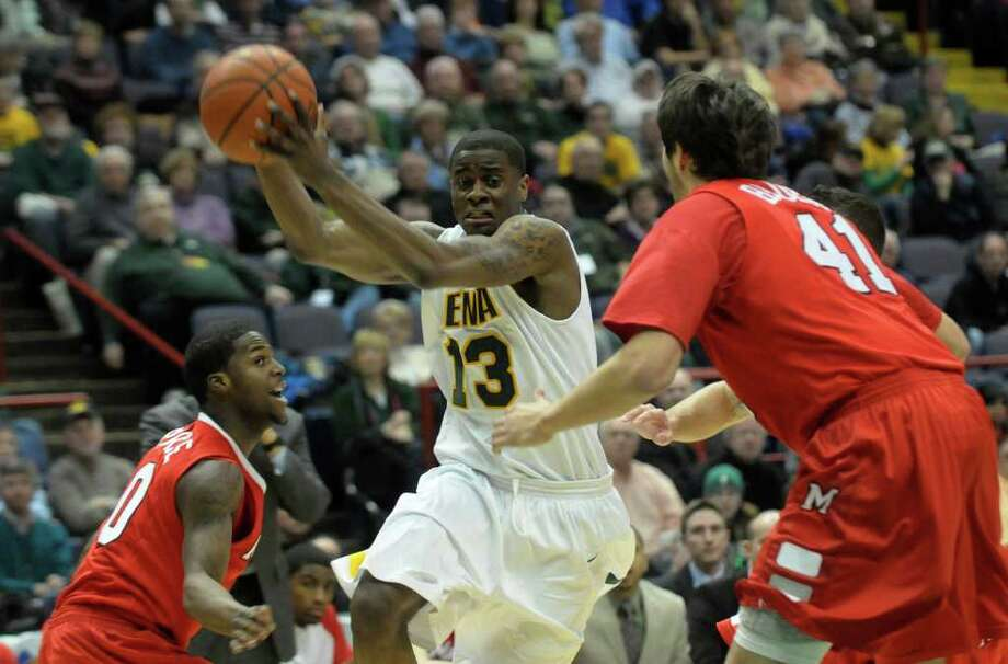 Siena's Clarence Jackson (13) is defended by Marist's Jay Bowie ,left, and Korey Bauer ,right, during their Metro Atlantic Athletic Conference basketball game at the Times Union Center in Albany,N.Y., Sunday, Feb. 27, 2011. (Hans Pennink / Special to the Times Union) College Sports Photo: Hans Pennink