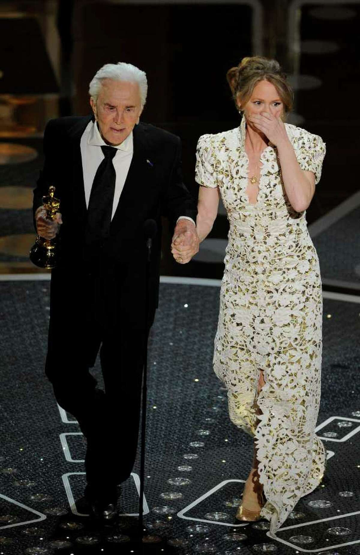 Kirk Douglass escorts Melissa Leo after she accepted the Oscar for best actress in a supporting role for