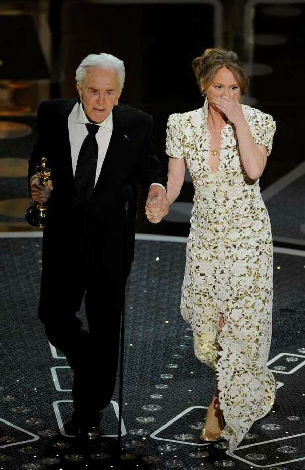 "Kirk Douglass escorts Melissa Leo  after she accepted the Oscar for best actress in a supporting role for ""The Fighter"" at the 83rd Academy Awards on Sunday, Feb. 27, 2011, in the Hollywood section of Los Angeles. (AP Photo/Mark J. Terrill) Photo: Mark J. Terrill"