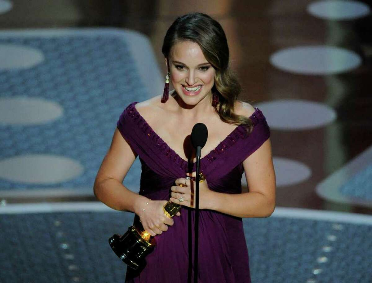 Natalie Portman accepts the Oscar for best performance by an actress in a leading role for