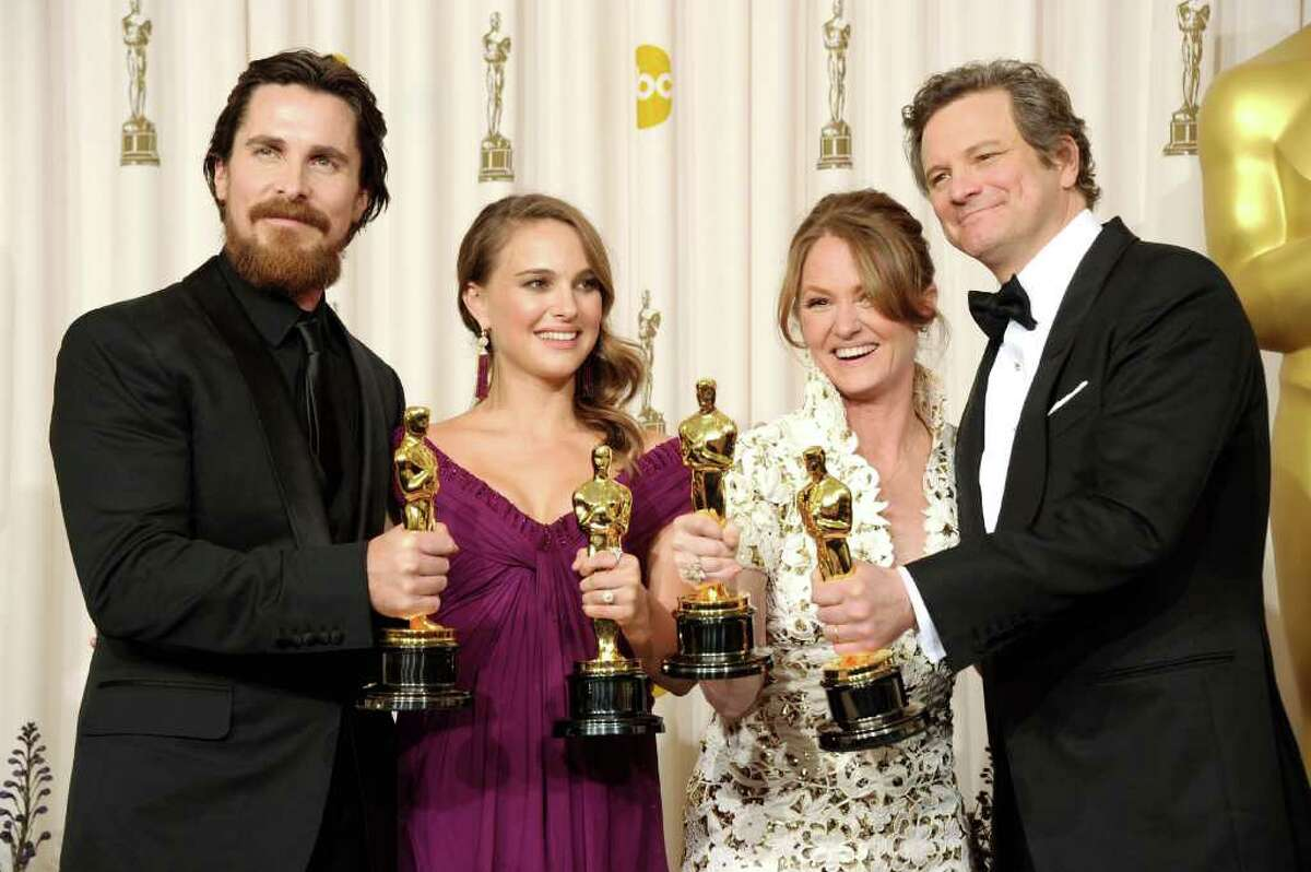 HOLLYWOOD, CA - FEBRUARY 27: (L-R) Actor Christian Bale, winner of the award for Best Actor in a Supporting Role for 'The Fighter', Natalie Portman, winner of the award for Best Actress in a Leading Role for 'Black Swan', Melissa Leo, winner of the award for Best Actor in a Supporting Role for 'The Fighter', and Colin Firth, winner of the award for Best Actor in a Leading Role for 'The King's Speech', pose in the press room during the 83rd Annual Academy Awards held at the Kodak Theatre on February 27, 2011 in Hollywood, California. (Photo by Jason Merritt/Getty Images) *** Local Caption *** Christian Bale;Natalie Portman;Melissa Leo;Colin Firth
