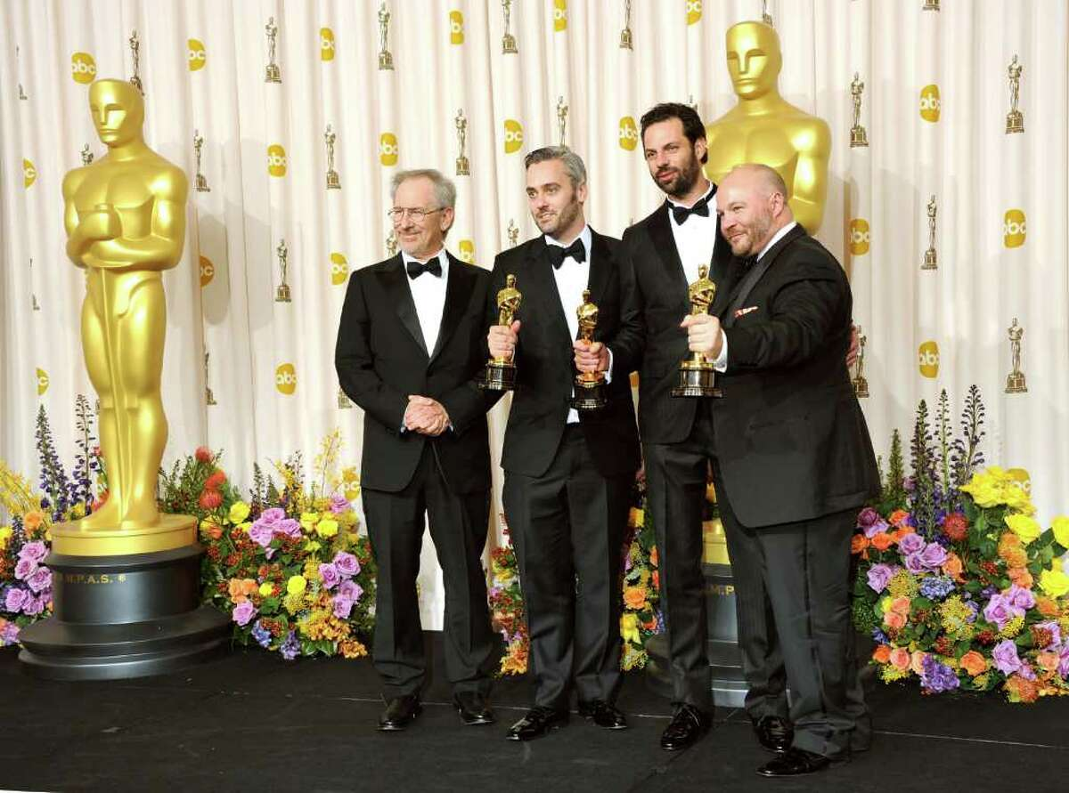 HOLLYWOOD, CA - FEBRUARY 27: (L-R) Presenter Steven Spielberg poses with producers Emile Sherman, Iain Canning, and Gareth Unwin, winners of the award for Best Picture for 'The King's Speech', pose in the press room during the 83rd Annual Academy Awards held at the Kodak Theatre on February 27, 2011 in Hollywood, California. (Photo by Jason Merritt/Getty Images) *** Local Caption *** Gareth Unwin;Iain Canning;Emile Sherman;Steven Spielberg