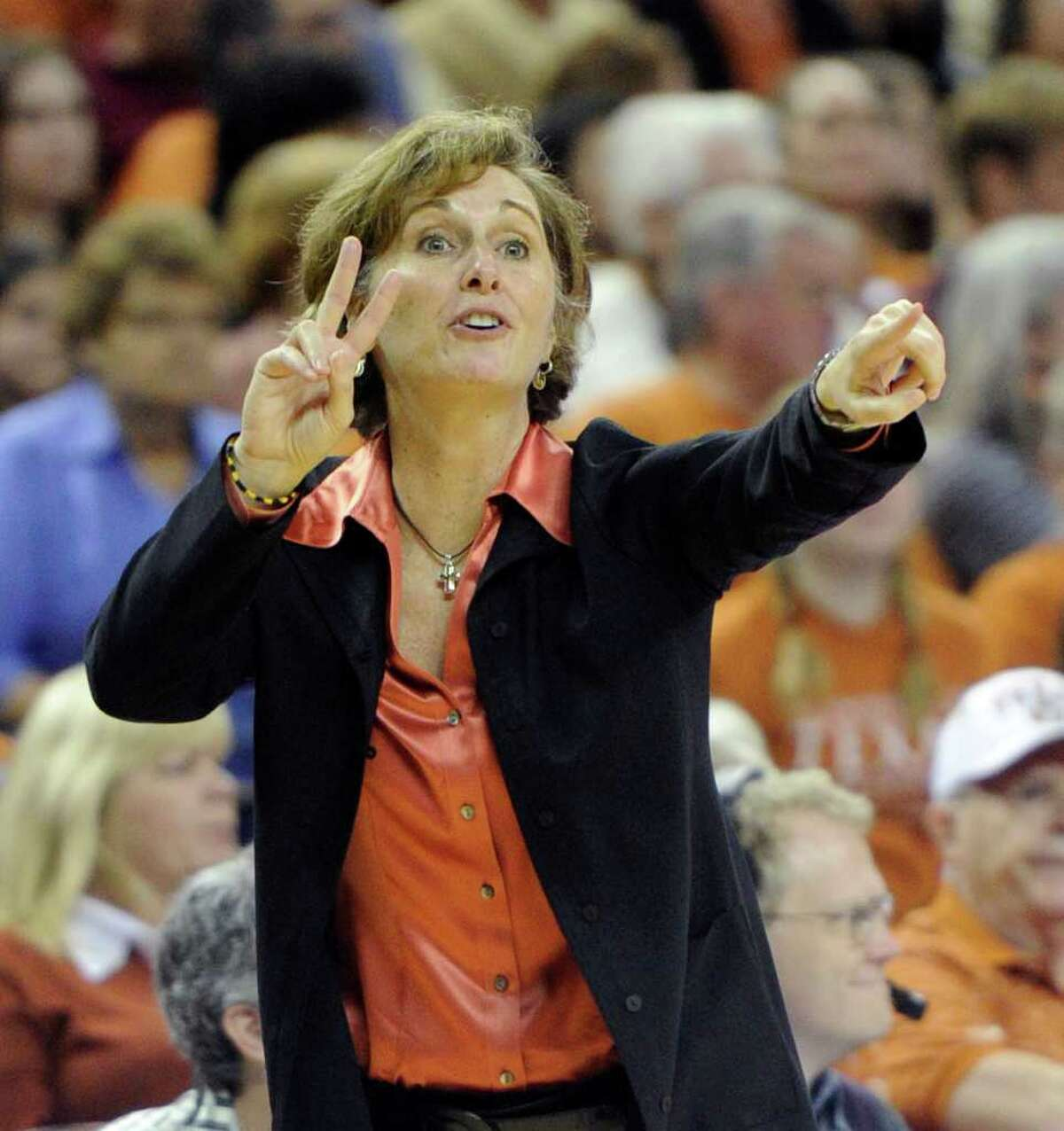 Texas women's basketball coach Gail Goestenkors directs her team against Texas A&M during the second half of an NCAA college basketball game Sunday, Feb. 27, 2011, in Austin, Texas. Texas A&M won 68-65.