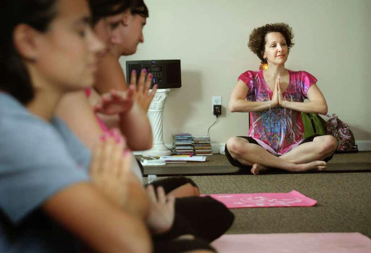 Linda Antignani, owner of Mother's Embrace Yoga studio, leads a prenatal yoga class Thursday August 24, 2010 in Shelton, Conn.Yoga studios and other businesses services are concerned a proposal to slap a sales tax on them could create some financial disharmony for clients and hurt business.