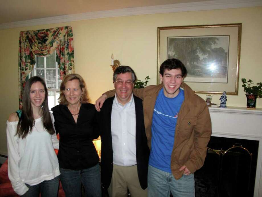 Selectman Rob Mallozzi announced his candidacy for First Selectman Monday morning at his home with his family. Here he stands with his wife Elizabeth and his two kids Kit and Robby IV. Photo: Contributed Photo;Paresh Jha Staff Photo, Contributed Photo / New Canaan News
