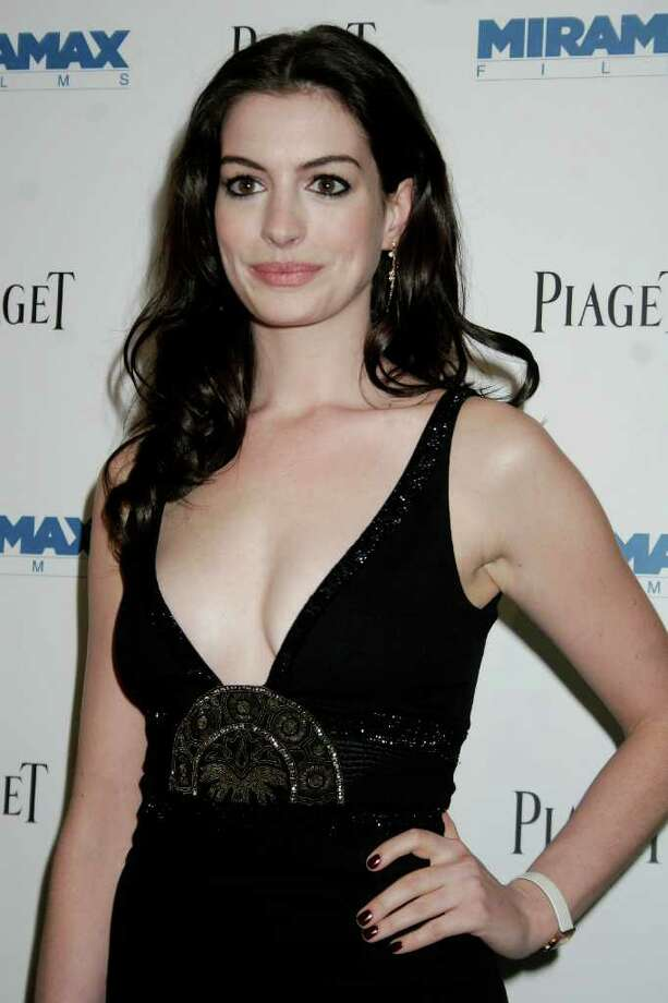 Anne Hathaway's hair has been through numerous transitions,  but had mostly stayed beneath her shoulders during her early steps into the spotlight.  Photo: ANDY KROPA, AP / AP
