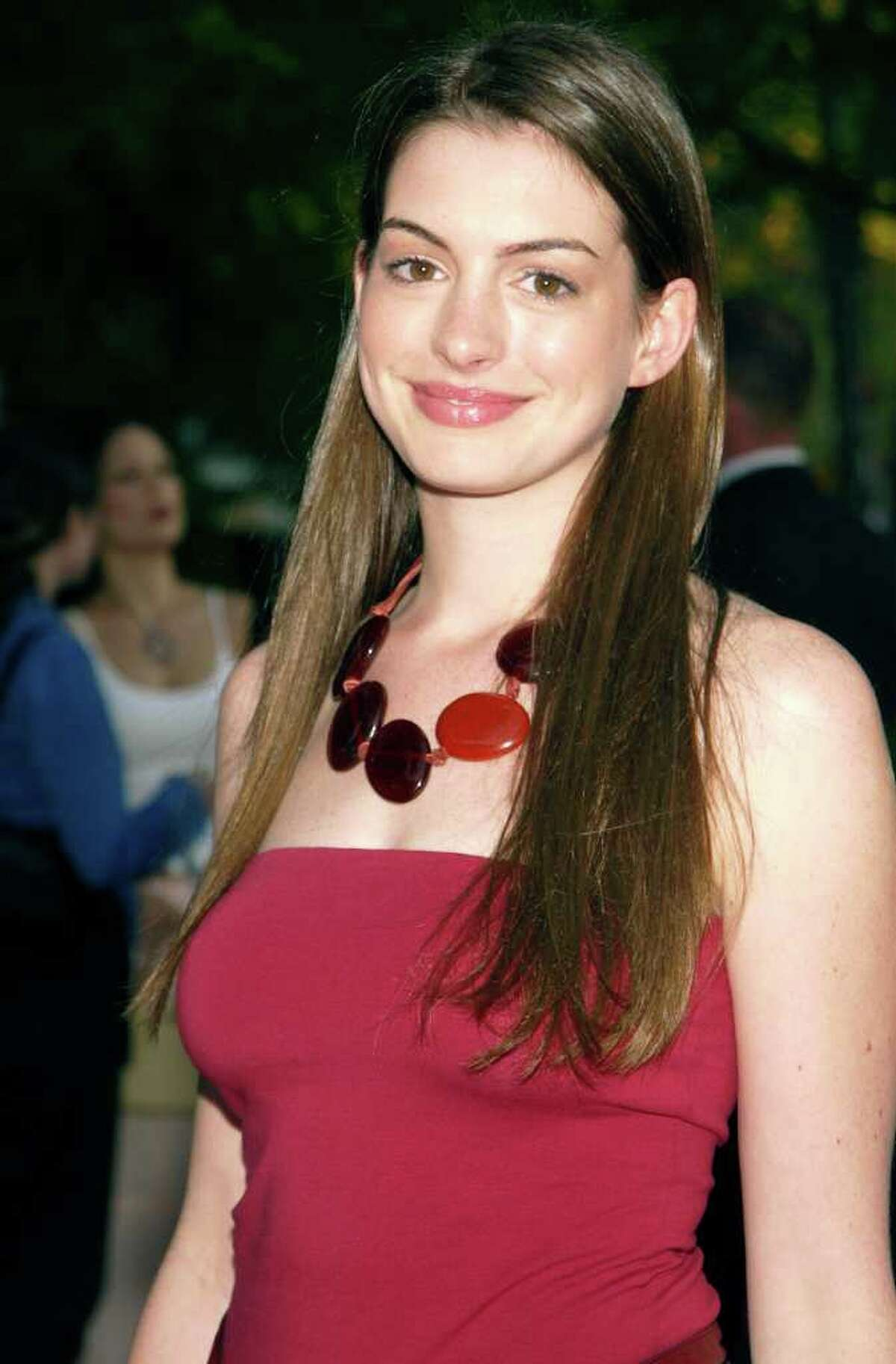 NEW YORK-JULY 16: Actress Anne Hathaway arrives at the world premiere of the fifth season of Sex and the City on July 16, 2002, at the American Museum of Natural History in New York City.