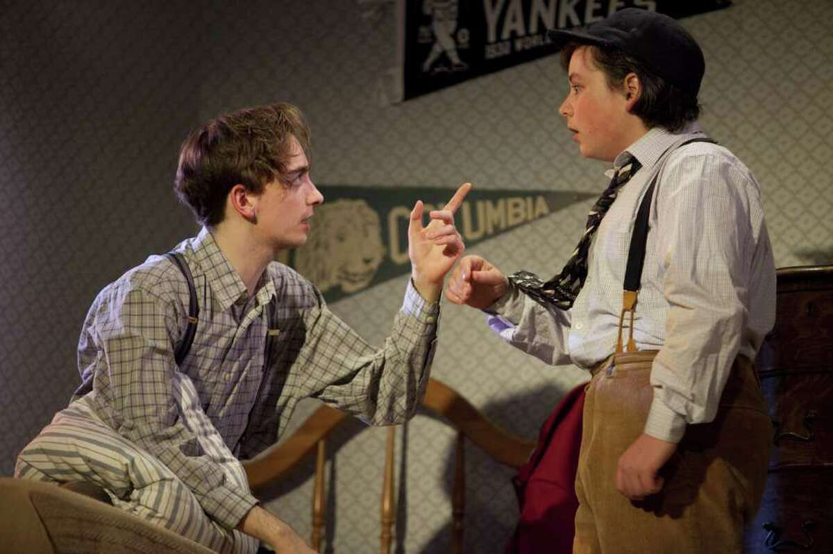 """Matthew Van Gessel '11 as Stanley Jerome, and Ryan Shea '13 as Eugene Jerome rehearse for the opening of """"Brighton Beach Memoirs"""" at Staples High School."""
