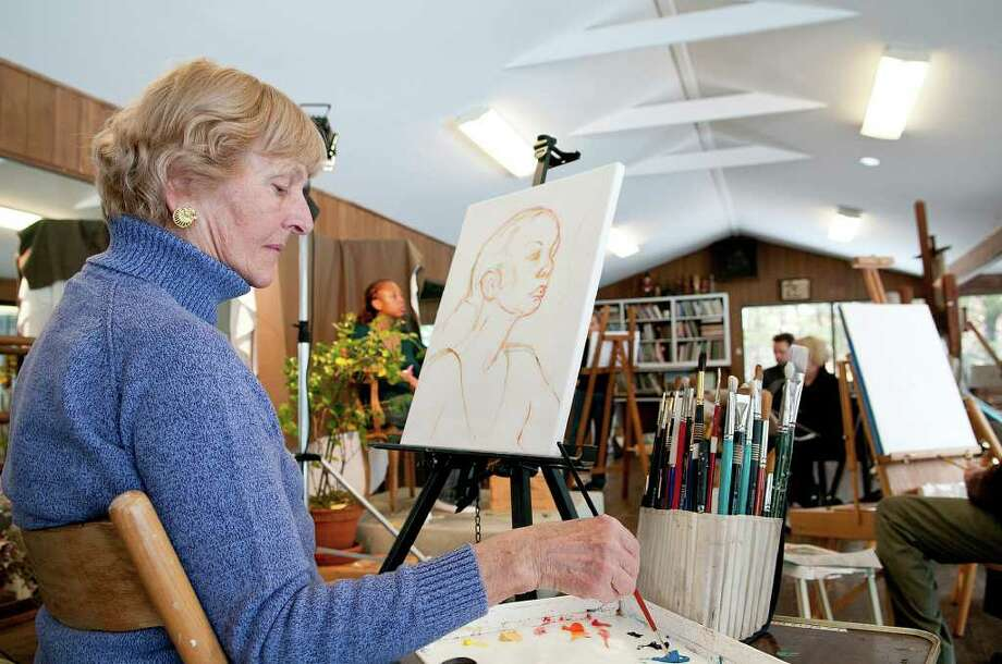 Betty Petschek, New Canaan, works on a painting at Elizabeth Gaynor's Southport, CT studio on Monday, February 28, 2011. Photo: Shelley Cryan / Shelley Cryan freelance; Westport News freelance
