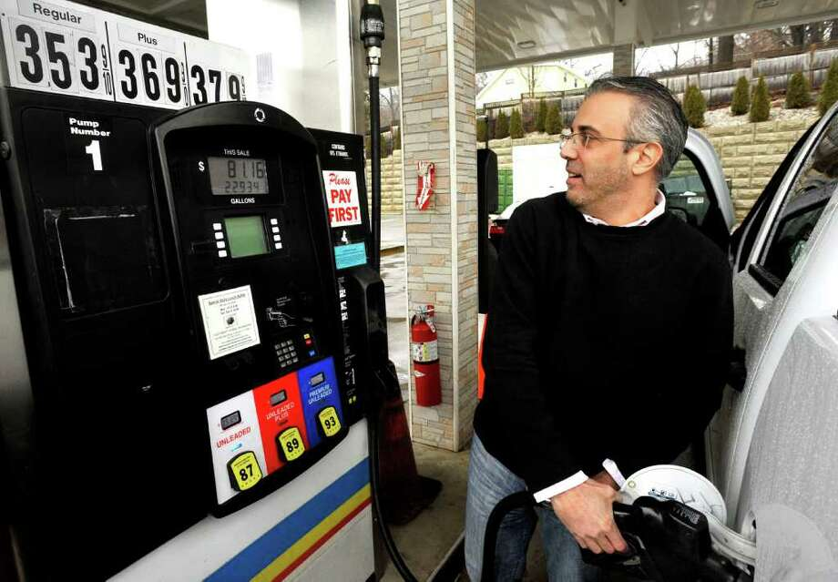Frank Giner, 45, of Danbury, fills up at Exxpress Fuels in Danbury, Monday, Feb. 28, 2011. Photo: Michael Duffy / The News-Times