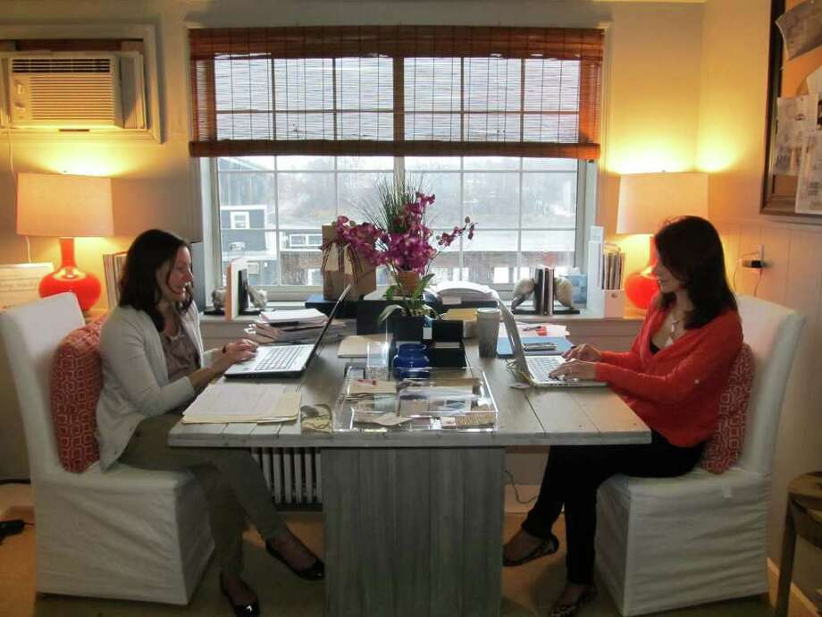 Jody Peters, left, and Shannon Manchester work in the Design Serendipity Interiors office which opened in January in Westport. Photo: Stephanie Paulino, Contributed Photo / Westport News