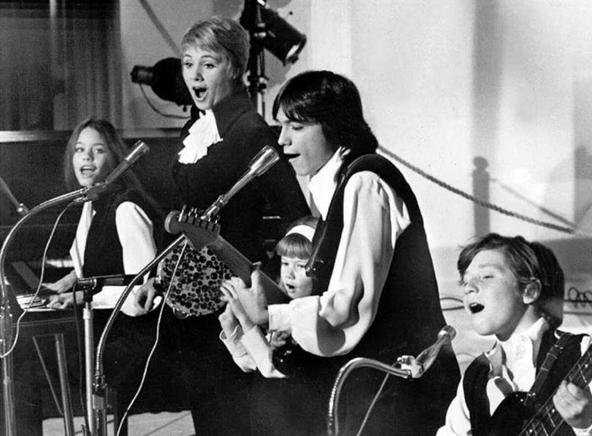 Susan Dey, left, Shirley Jones, Suzanne Crough, David Cassidy and Danny Bonaduce get down on
