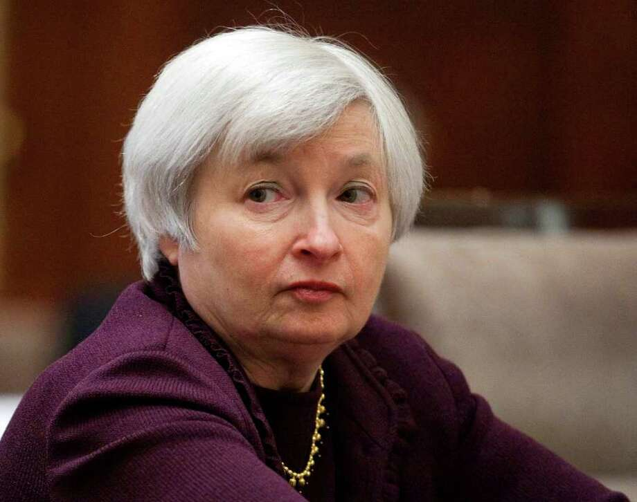 Janet Yellen, vice chairman of the U.S. Federal Reserve, listens during an open meeting of the Federal Reserve Board in Washington, D.C., U.S., on Thursday, Dec. 16, 2010. The Federal Reserve Board proposed rules that may slash debit-card interchange fees by 90 percent. Retailers and financial institutions are fighting in Washington over debit card swipe fees, but the end result might not translate into consumer savings or job growth, experts say. Photographer: Joshua Roberts/Bloomberg *** Local Caption *** Janet Yellen Photo: Joshua Roberts, Bloomberg / © 2010 Bloomberg Finance LP