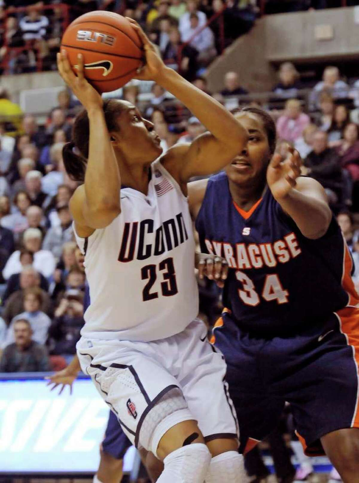 Connecticut's Maya Moore gets set to shoot as Syracuse's Shakeya Leary defends during the first half of an NCAA college basketball game in Storrs, Conn., Monday, Feb. 28, 2011. (AP Photo/Bob Child)