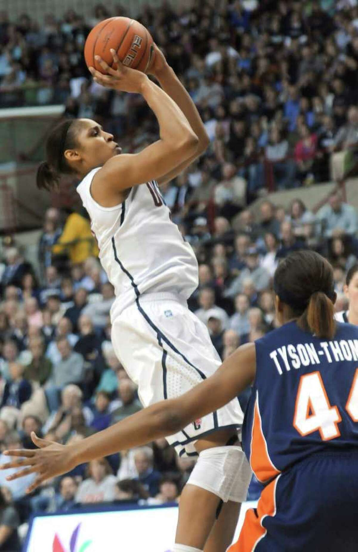 Connecticut's Maya Moore goes up for a jump shot as Syracuse's Carmen Tyson-Thomas watches in the first half of an NCAA college basketball game in Storrs, Conn., Monday, Feb. 28, 2011. (AP Photo/Bob Child)
