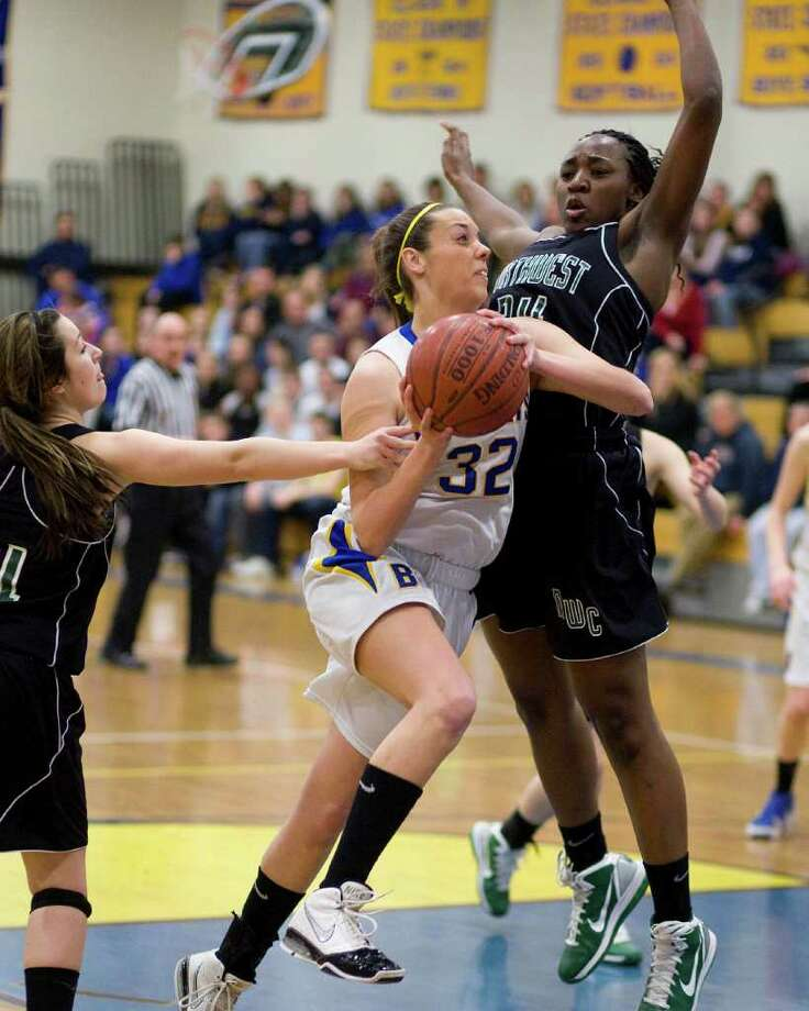 Brookfield's Jaime Bickelhaupt drives past Northwest Catholic's Alyssa Reaves during their Class L state tournament first round game Monday night at Brookfield High School. Photo: Barry Horn / The News-Times Freelance