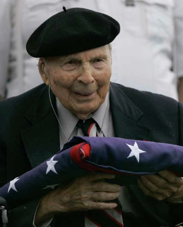 FILE -- In a May 26, 2008 file photo Frank Buckles receives an American flag during Memorial Day activities at the National World War I Museum in Kansas City, Mo. Biographer and family spokesman David DeJonge said in a statement that Frank Woodruff Buckles died early Sunday, Feb. 27, 2011 of natural causes in his home in Charles Town, W.Va.   (AP Photo/Charlie Riedel) Photo: Charlie Riedel