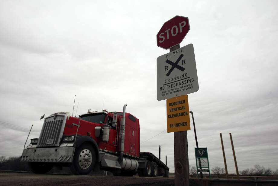 A drilling boom in the Eagle Ford shale formation has sparked a significant increase in freight trucks traveling across train tracks. Union Pacific's billboard campaign aims to warn truck drivers about railroad safety and accident prevention. Photo: Helen L. Montoya/hmontoya@express-news.net