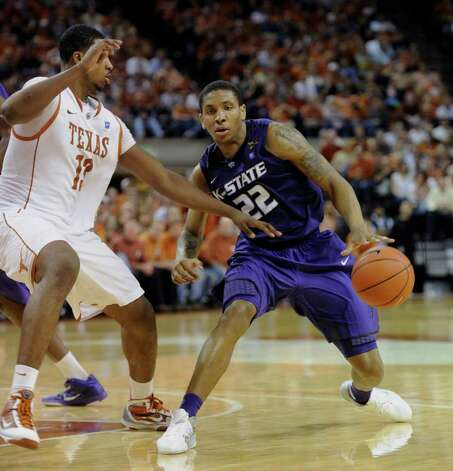Kansas State guard Rodney McGruder (right) brings the ball up against Texas forward Tristan Thompson during the second half on Monday, Feb. 28, 2011, in Austin. McGruder was the high scorer for Kansas State with 22 points as Kansas State won 75-70. Photo: Michael Thomas/Associated Press