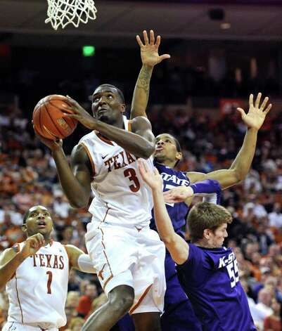 Texas forward Jordan Hamilton (front) goes to the basket against Kansas State guard Will Spradling (right) and guard Rodney McGruder (rear) during the second half on Monday, Feb. 28, 2011, in Austin. Kansas State won 75-70. Photo: Michael Thomas/Associated Press
