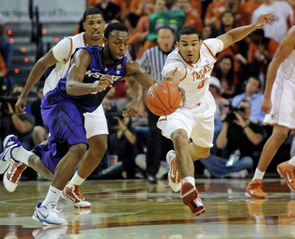 Texas guard Cory Joseph (right) races for the loose ball with Kansas State guard Jacob Pullen (left) during the first half on Monday, Feb. 28, 2011, in Austin. Photo: Michael Thomas/Associated Press