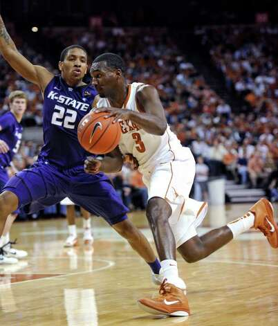 Texas forward Jordan Hamilton (right) drives around Kansas State guard Rodney McGruder during the first half on Monday, Feb. 28, 2011, in Austin. Photo: Michael Thomas/Associated Press