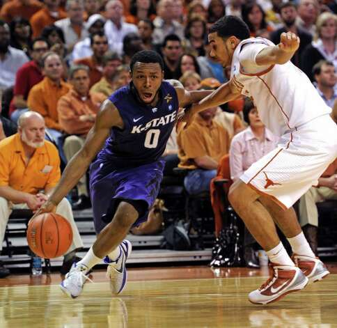 Kansas State guard Jacob Pullen (left) drives around Texas guard Cory Joseph during the second half on Monday, Feb. 28, 2011, in Austin. Kansas State won 75-70. Photo: Michael Thomas/Associated Press