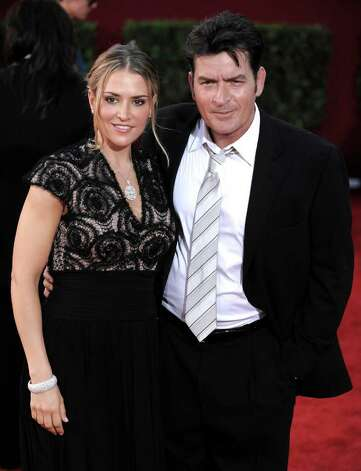 FILE - In this Sept. 20, 2009, file photo, actor Charlie Sheen, right, and his wife Brooke Mueller arrive at the 61st Primetime Emmy Awards in Los Angeles. Photo: AP