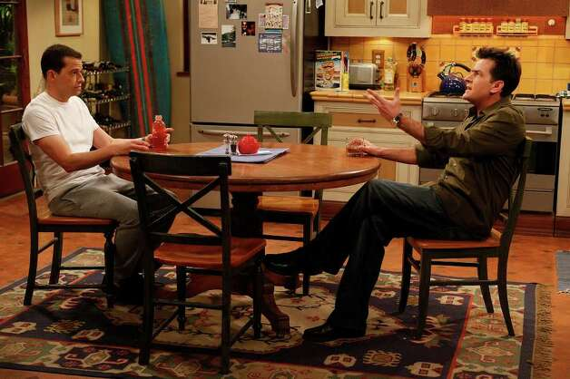 "In this undated publicity image released by CBS, Jon Cryer, left, and Charlie Sheen are shown during the taping of ""Two and a Half Men,"" in Los Angeles. Photo: AP"