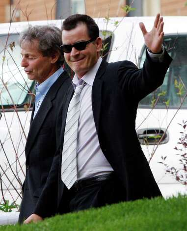 FILE - In this June 7, 2010 file photo, Charlie Sheen leaves the Pitkin County Courthouse  with his attorney Richard Cummins in Aspen, Colo. Photo: AP