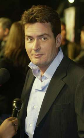 "Actor Charlie Sheen, one of the stars of the new comedy film ""The Big Bounce"" poses as he arrives for the film's premiere in Los Angeles in this January 29, 2004 file photo. Actor Charlie Sheen on April 22, 2006, denied charges from his estranged wife, actress Denise Richards, that he had been abusive toward her and their daughters and had threatened to kill her. REUTERS/Fred Prouser Photo: FRED PROUSER, REUTERS / X00224"