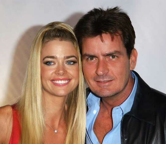 "** FILE ** Denise Richards and husband Charlie Sheen are shown at the ""Rodeo Drive Walk Of Style"" in this Sept. 9, 2003 file photo, in Beverly Hills, Calif. Photo: PAUL SKIPPER, AP / ARROYO"