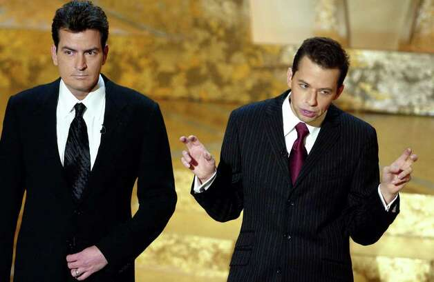 "Actors Charlie Sheen, left and Jon Cryer open the show at the 30th Annual People's Choice Awards Sunday, Jan. 11, 2004, in Pasadena, Calif. Sheen says he's having fun portraying a G-rated version of his former self on the CBS comedy, ""Two and Half Men.'' Photo: MARK J. TERRILL, AP / AP"