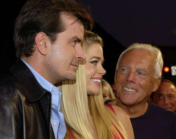 "Giorgio Armani, right, poses with Charlie Sheen, left, and Sheen's wife, Denise Richards, as they arrive for the fashion show and award ceremony to honor Armani with the inaugural ""Rodeo Drive Walk of Style"" award Tuesday, Sept. 9, 2003, in the Beverly Hills section of Los Angeles. Photo: CHRIS WEEKS, AP / AP"