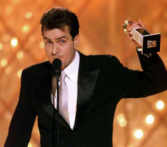 "Actor Charlie Sheen accepts his award for best performance by an actor in a television series for his work in ""Spin City,"" at the 59th Annual Golden Globe Awards in Beverly Hills, Calif., Sunday, Jan. 20, 2002. Photo: CHRIS HASTON, AP / NBC"