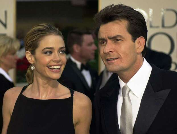 "** FILE ** Actor Charlie Sheen, right, of television's ""Spin City,"" is joined by fiance and actress Denise Richards, in Beverly Hills, Calif., in this Jan. 20, 2002 file photo. Sheen, one of Hollywood's best-known bachelors, has married actress Denise Richards, his publicist said Sunday, June 16, 2002. Sheen and Richards were wed Saturday night at the home of producer Gary David Goldberg in Los Angeles, said publicist Tracy Shaffer. Photo: KEVORK DJANSEZIAN, AP / AP"