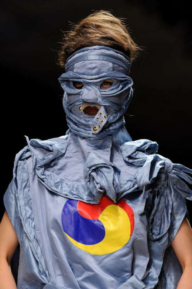 PARIS - OCTOBER 01:  A model walks the runway during the Vivienne Westwood Ready to Wear Spring/Summer 2011 show during Paris Fashion Week on October 1, 2010 in Paris, France.  (Photo by Pascal Le Segretain/Getty Images) Photo: Pascal Le Segretain, Getty Images / 2010 Getty Images