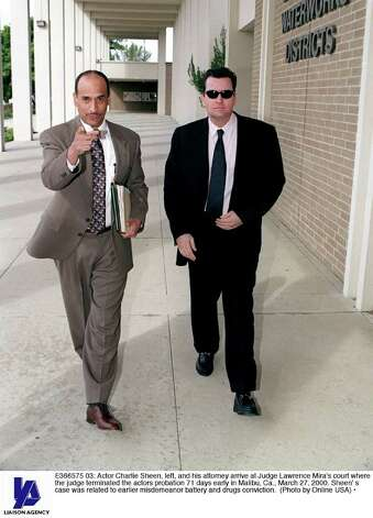 E366575 03: Actor Charlie Sheen, left, and his attorney arrive at Judge Lawrence Mira's court where the judge terminated the actors probation 71 days early in Malibu, Ca., March 27, 2000. Sheen'' s case was related to earlier misdemeanor battery and drugs conviction. (Photo by Online USA) Photo: Getty Images / Getty Images North America