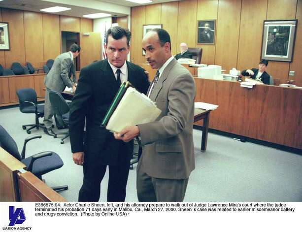 E366575 04: Actor Charlie Sheen, left, and his attorney prepare to walk out of Judge Lawrence Mira's court where the judge terminated his probation 71 days early in Malibu, Ca., March 27, 2000. Sheen'' s case was related to earlier misdemeanor battery and drugs conviction. (Photo by Online USA) Photo: Getty Images / Getty Images North America