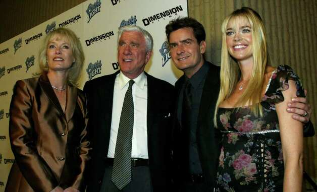 "WESTWOOD - OCTOBER 20:  (L-R) Mrs. Leslie Nielsen, Leslie Nielsen, Charlie Sheen and Denise Richards attend the film premiere of ""Scary Movie 3"" at the AMC Theatres Avco Cinema on October 20, 2003 in Westwood, California.  The film ""Scary Movie 3"" opens nationwide on October 24, 2003. Photo: Frederick M. Brown, Getty Images / 2003 Getty Images"