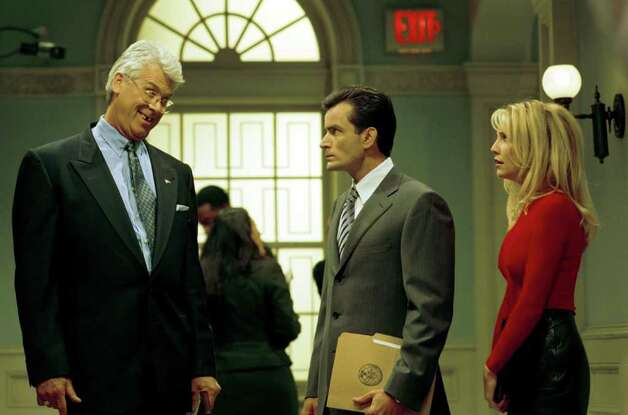 "378334 10: Actor Charlie Sheen Will Join The Cast Of The Popular Ensemble Comedy Series, ""Spin City,"" Which Airs On The Abc Television Network. Pictured (L-R) Barry Bostwick, Charlie Sheen And Heather Locklear. Photo: Getty Images / Getty Images North America"