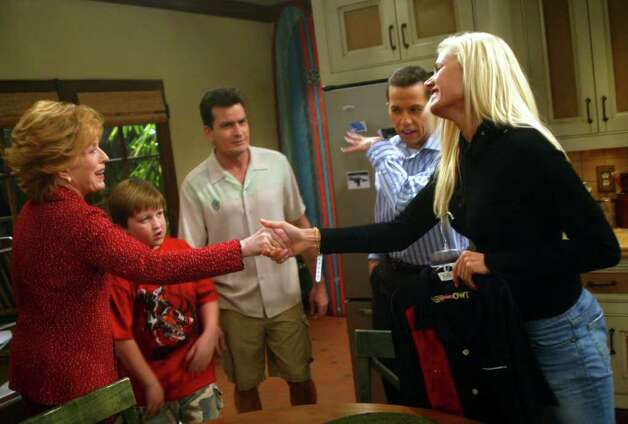"BURBANK, CA - SEPTEMBER 9:  Big Brother 6 contestant Janelle Pierzina meets actors (l-r) Holland Taylor, Angus T. Jones, Charlie Sheen and Jon Cryer before the taping of ""Two and A Half Men"" on the Warner Brothers Studios lot on September 9, 2005 in Burbank, California. Photo: Matthew Simmons, Getty Images / 2005 Getty Images"