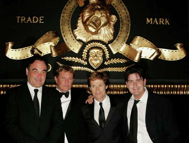 CANNES, FRANCE - MAY 21:  Actors (from 2nd L) Tom Berenger, Willem Dafoe and Charlie Sheen attend as producer Oliver Stone (L) is presented with the 'Metro-Goldwyn-Mayer Leo The Lion Award' at the Majestic Hotel during the 59th International Cannes Film Festival May 21, 2006 in Cannes, France. Photo: Peter Kramer, Getty Images / 2006 Getty Images
