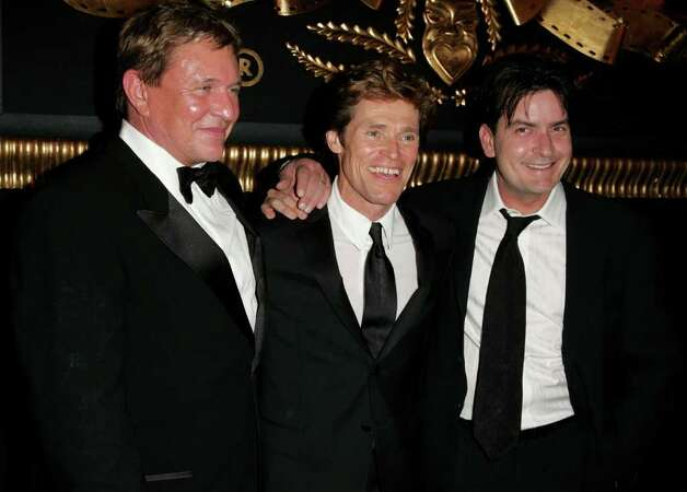 CANNES, FRANCE - MAY 21:  Actors (L-R) Tom Berenger, Willem Dafoe and Charlie Sheen attend the MGM Platoon Party at the Majestic Hotel during the 59th International Cannes Film Festival May 21, 2006 in Cannes, France. Photo: Peter Kramer, Getty Images / 2006 Getty Images