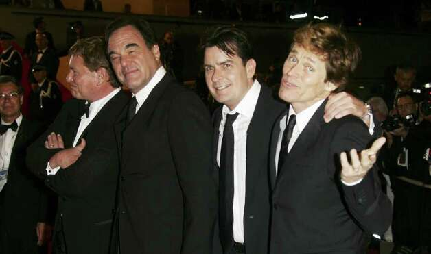 CANNES, FRANCE - MAY 21:  (L-R) US actors Tom Berenger, director OLiver Stone, actors Charlie Sheen and Willem Dafoe attend the 'Platoon' Screening at the Palais during the 59th International Cannes Film Festival May 21, 2006 in Cannes, France. Photo: Pascal Le Segretain, Getty Images / 2006 Getty Images