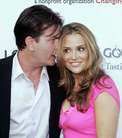 LOS ANGELES - JUNE 10:  Actor Charlie Sheen and girlfriend real estate investor Brooke Wolofsky arrive at Chrysalis' 5th Annual Butterfly Ball at the home of Fred and Carla Sands on June 10, 2006 in Los Angeles, California. Photo: Kevin Winter, Getty Images / 2006 Getty Images