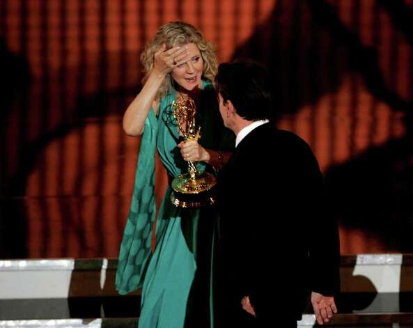 "LOS ANGELES, CA - AUGUST 27:  Actress Blythe Danner (L) accepts the award for Outstanding Supporting Actress in a Drama Series for ""Huff"" from Actor Charlie Sheen onstage at the 58th Annual Primetime Emmy Awards at the Shrine Auditorium on August 27, 2006 in Los Angeles, California. Photo: Vince Bucci, Getty Images / 2006 Getty Images"